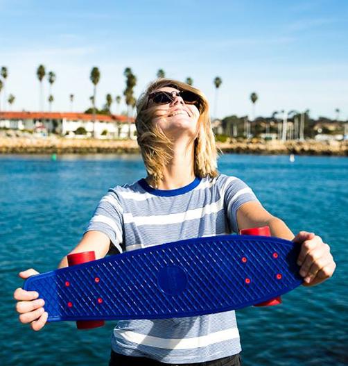 Girl-Holding-Penny-Skateboard